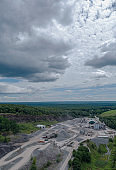 Aerial view on the open-cast quarry in Poconos, Pennsylvania. Vertical panorama.