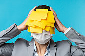 Adhesive Notes With Surgical Mask On The White Collar Worker Face