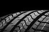 a black isolation rubber tire, on the grey backgrounds