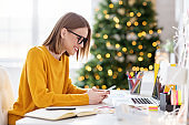 Delighted freelancer using smartphone on Christmas day