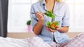 concept of healthy eating.   happy woman eating vegetable vegetarian salad