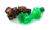 two crumpled plastic bottles garbage isolated