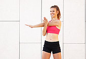 Positive sporty woman doing fitness exercise