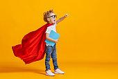 Little superhero studying at school