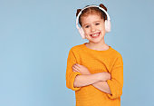 Girl listening to music and smiling