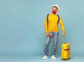 Man in mask travelling during quarantine