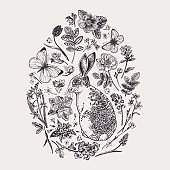 Herbal composition with flowers and rabbit.