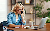 happy young   business woman at home office working on computer