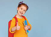 Cheerful girl approving school education