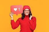 Ethnic female making wish in social media