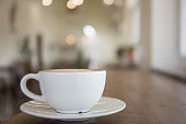 white coffee cup on table in shop.