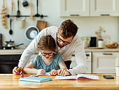 Father explaining lesson to kid