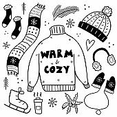 Winter clothes. Hat and scarf, sweater and mittens with snowflake and scandinavian design, headphones and christmas accessories doodle vector set