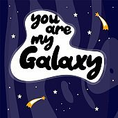 You are my galaxy. Hand drawn vector lettering. Doodle colored drawing with text, stars comets isolated on cosmic background. Trendy vector cartoon print on kids clothes sweatshirt poster