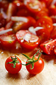 red cherry tomato on wooden background