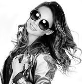 Beautiful fashionable woman with wavy hair wearing sunglasses.
