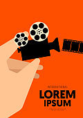 Movie poster design template background with human hand and vintage film camera