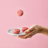 plate of macaroons in human hand