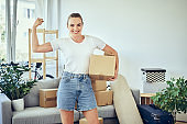 proud, woman, moving, new home, box, cardboard, carry, portrait, smiling, happy, people, renovation, working, home, house, room, success, celebrate, biceps, flexing, unfinished, decoration, improvement, female, one woman, moving in, standing, positive, ca