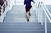 Fitness, health, and sport concept. Athletic man running upstairs