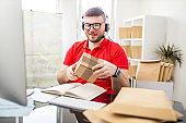 Salesman packing and checking shipment