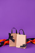 Mock up for Halloween sale massage on paper craft package bag for shopping with decorative bats on purple, seasonal holiday sale discount concept, traditional color, designer copy space