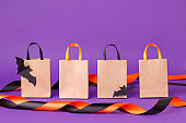 Mock up for Halloween sale massage on paper craft package for shopping on purple background, October autumn seasonal holiday sale discount concept, traditional color, designer copy space