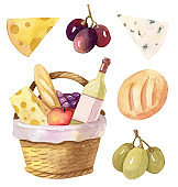 Picnic basket with wine, cheese and bread