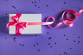 White present box with pink bow