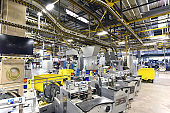 modern machines for transportation in a large print shop for production of newspapers & magazines