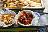 Korea street food, spicy rice cake,  and fish cake, and fried dumplings.
