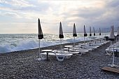 Empty lounge chairs and parasols on beach