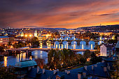 Beautiful panoramic evening view to the lit cityscape of Prague, Czech Republic