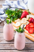 Pink smoothie with banana and strawberry for healthy, vegan diet