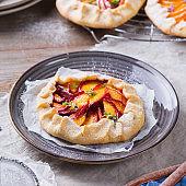 Homemade seasonal summer fruit galette, tart, pie with nectarines, peaches