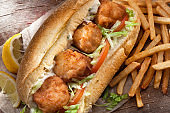 Deep Fried Sea Scallop Po Boy Sandwich with French Fries, Tartar Sauce and Lemon