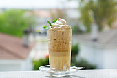 Trendy iced frothy ultra fluffy Dalgona instant Coffee drink