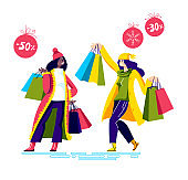 Happy girls holding shopping bags after holiday sales and special offers