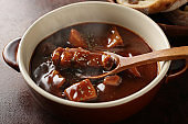 Beef stew on a reddish brown background
