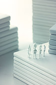 Stacked white books and human