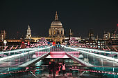 People at night in Saint Paul's Cathedral walking on the bridge