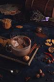 Hot chocolate in dark moody background