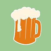 Modern beer mug with foam on pastel green background, flat illustration. Happy Saint Patricks day. Simple Hand drawn vector. Beer in glass sticker, emblem or icon. Delicious drink