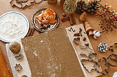 Making gingerbread cookies, Christmas holiday tradition. Raw gingerbread dough and metal cutters