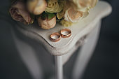 Wedding rings with flowers on the table