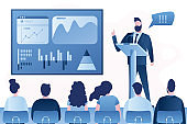 Business presentation or conference. Successful businessman performs on rostrum in front of an audience.