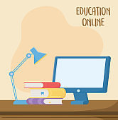 online education, computer books and desk lamp study