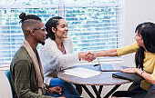 Young couple meeting with financial advisor or realtor