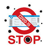 Red Stop sign and boarding pass, covid-19 pandemic. Ban on flights, movements and travels. Global virus.