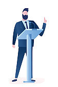 Businessman Gives Lecture. Stand near podium, speak into microphone.Handsome politician